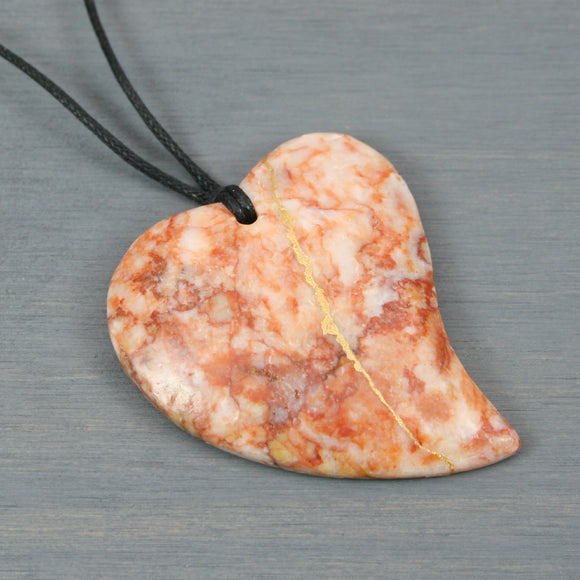 Redline marble kintsugi heart necklace on black cotton cord from A Kintsugi Life