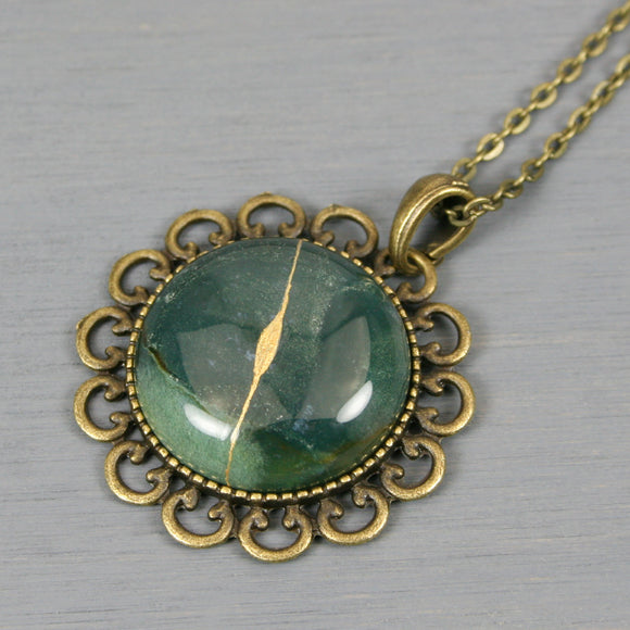 Moss agate kintsugi pendant in antiqued brass setting on chain from A Kintsugi Life