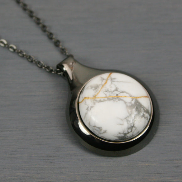 White howlite kintsugi pendant in a gunmetal setting on chain from A Kintsugi Life