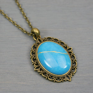 Blue dolomite stone kintsugi pendant in an antiqued brass setting on chain from A Kintsugi Life