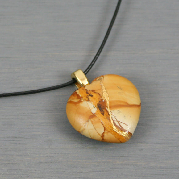 Picture jasper broken heart pendant with kintsugi repair on black cotton cord from A Kintsugi Life