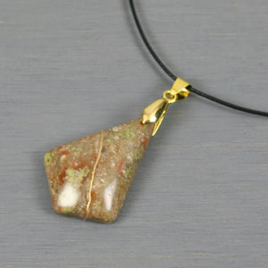 Autumn jasper pendant with kintsugi repair on black cotton cord from A Kintsugi Life