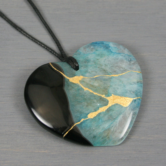 Turquoise blue druzy agate and black agate kintsugi heart pendant on black cotton cord from A Kintsugi Life