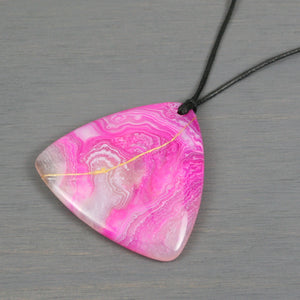 Pink and white agate triangle pendant with kintsugi repair on black cotton cord