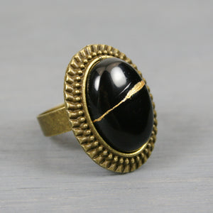 Black onyx kintsugi ring in an antiqued brass adjustable setting