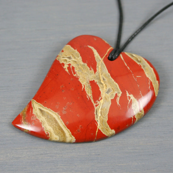 Brecciated jasper broken heart pendant with kintsugi repair on black cotton cord from A Kintsugi Life