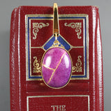 Purple dolomite with kintsugi repair on gold plated steel bookmark