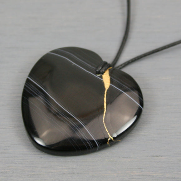 Black agate kintsugi heart pendant on black cotton cord