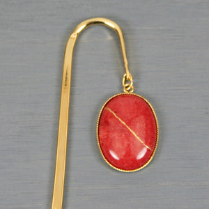 Coral dolomite with kintsugi repair on gold plated steel bookmark
