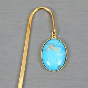 Turquoise howlite with kintsugi repair on gold plated steel bookmark