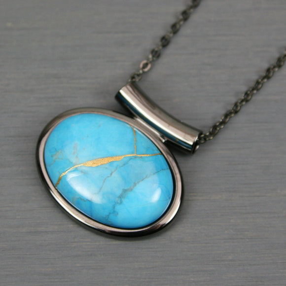 Turquoise howlite kintsugi pendant in a gunmetal setting on chain