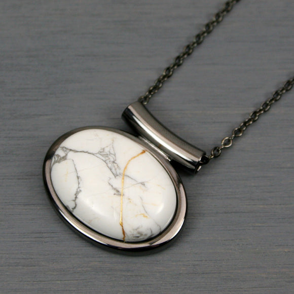 White howlite kintsugi pendant in a gunmetal setting on chain
