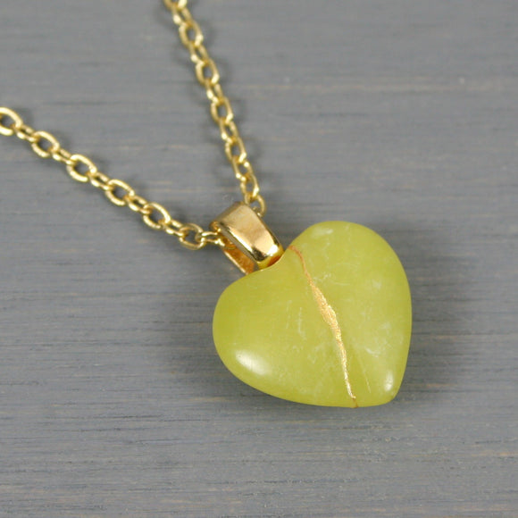 Yellow green stone broken heart pendant with kintsugi repair on chain necklace
