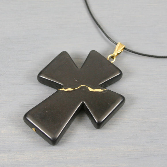 Black howlite kintsugi cross pendant on black cotton cord necklace