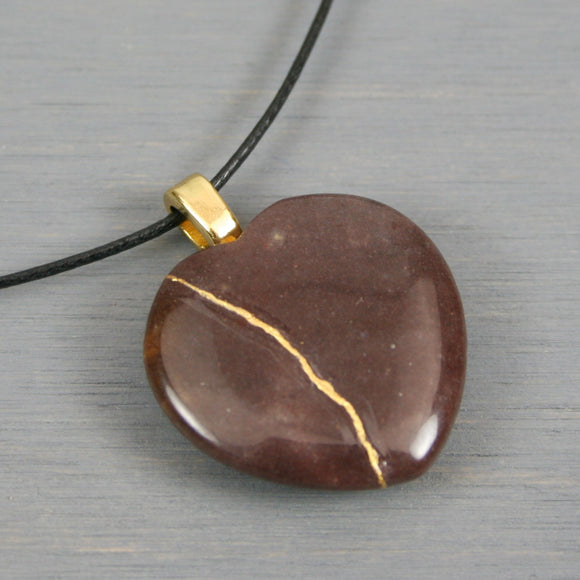 Purple aventurine broken heart pendant with kintsugi repair on black cotton cord