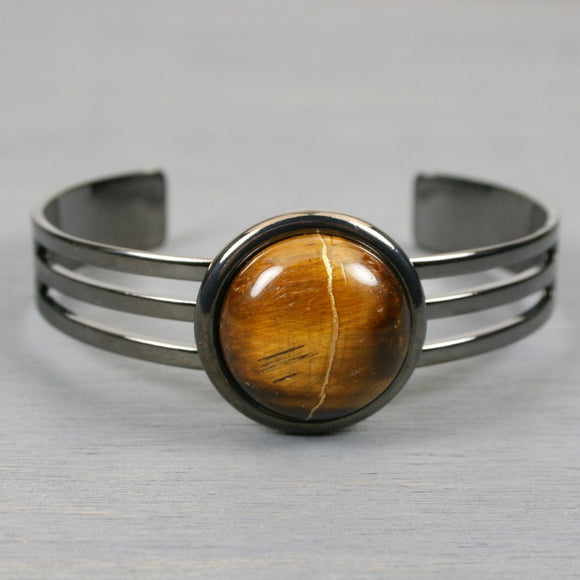 Tiger eye kintsugi bracelet in a gunmetal cuff setting