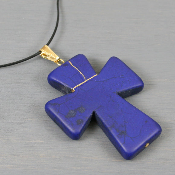 Blue howlite kintsugi cross pendant on black cotton cord necklace