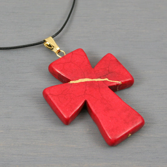 Red howlite cross pendant on black cotton cord necklace