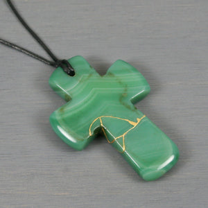 Green banded agate kintsugi cross pendant on black cotton cord necklace