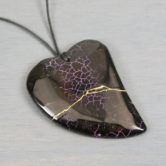 Black and pink dragon veins agate broken heart pendant with kintsugi repair on black cotton cord