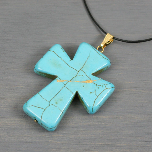 Turquoise howlite kintsugi cross pendant on black cotton cord necklace