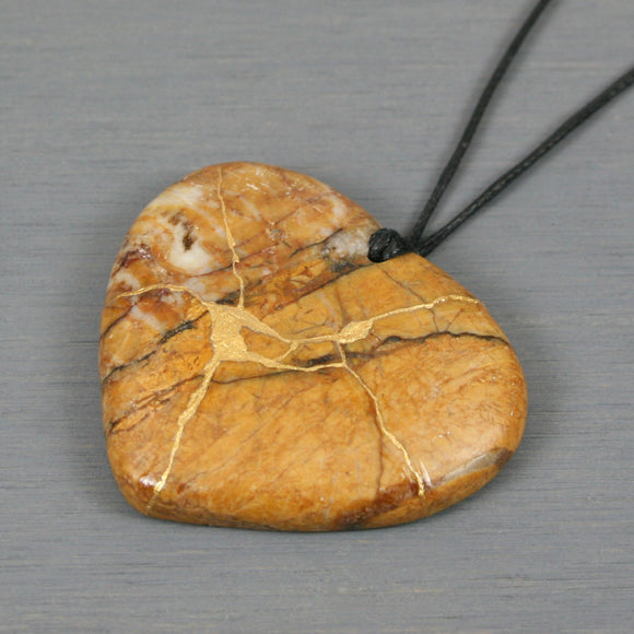 Red creek jasper broken heart pendant with kintsugi repair on black cotton cord