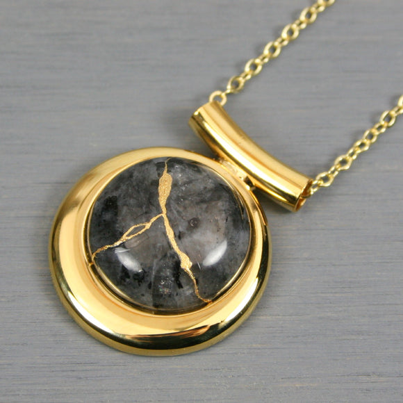 Larvikite (or blue labradorite) kintsugi pendant in a gold setting on chain