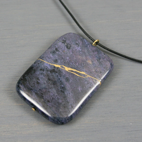 Purple dumortierite pendant with kintsugi repair on black cotton cord