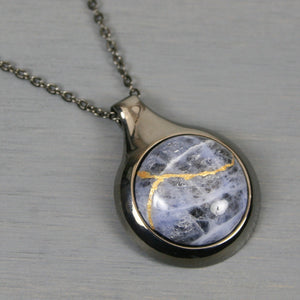 Sodalite kintsugi pendant in a gunmetal setting on chain