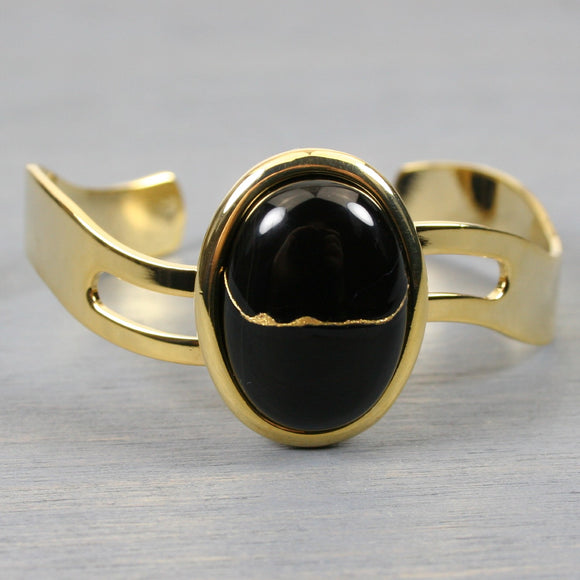Black onyx kintsugi bracelet in a gold cuff setting