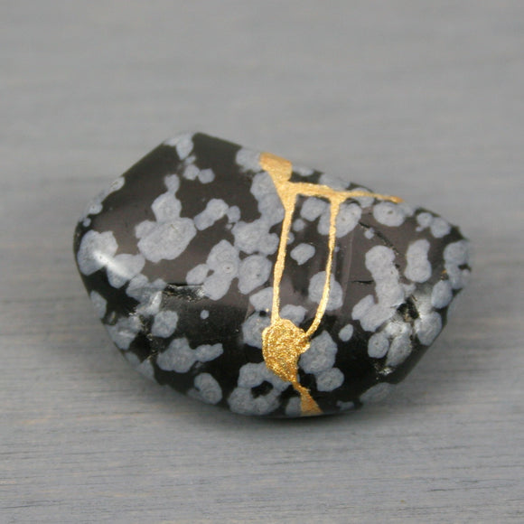 Small kintsugi repaired snowflake obsidian tumbled stone