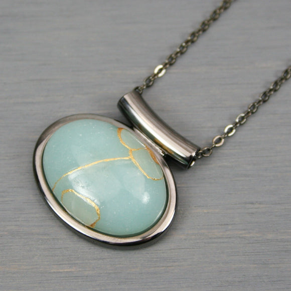 Amazonite kintsugi pendant in a gunmetal setting on chain