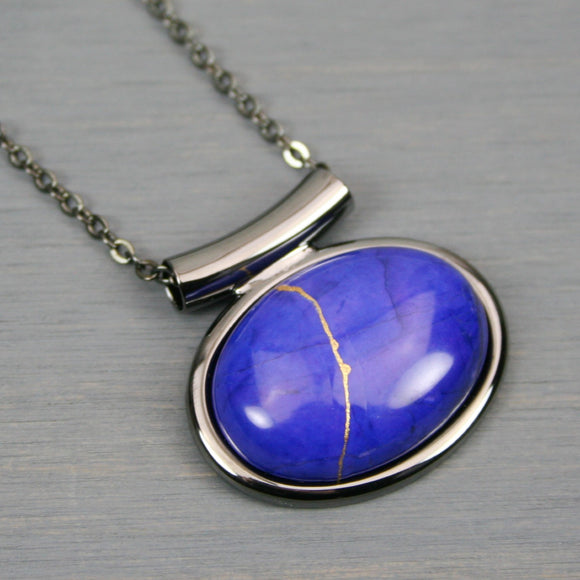Lapis howlite kintsugi pendant in a gunmetal setting on chain