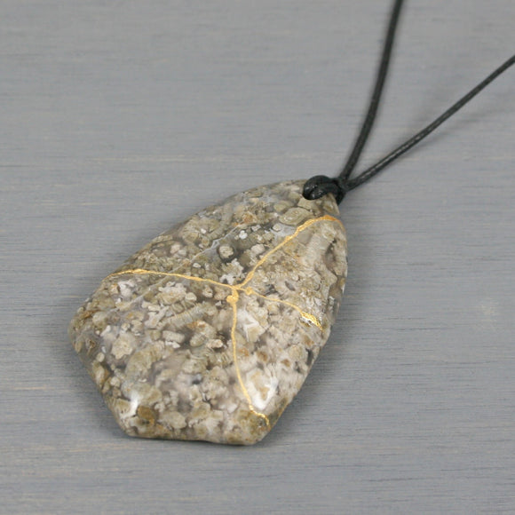 White blossom agate pendant with kintsugi repair on black cotton cord