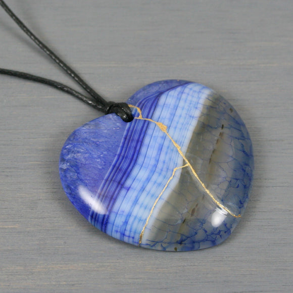 Blue dragon veins agate broken heart pendant with kintsugi repair on black cotton cord