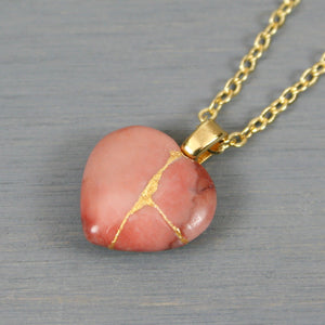 Rhodonite broken heart pendant with kintsugi repair on chain necklace