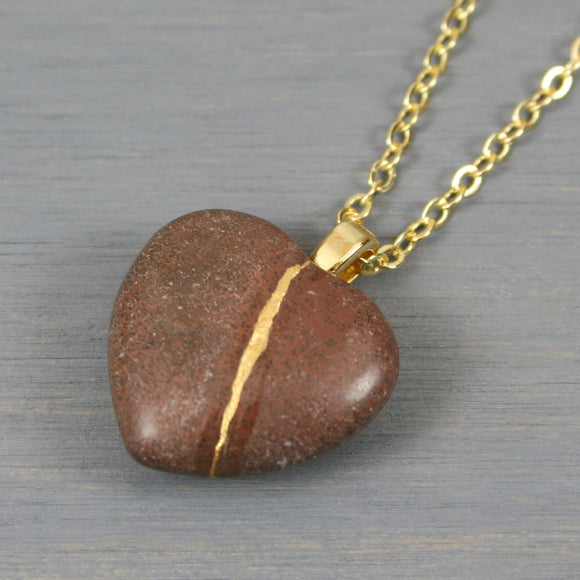 Brown stone broken heart pendant with kintsugi repair on chain necklace