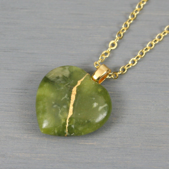 Nephrite jade broken heart pendant with kintsugi repair on a chain necklace