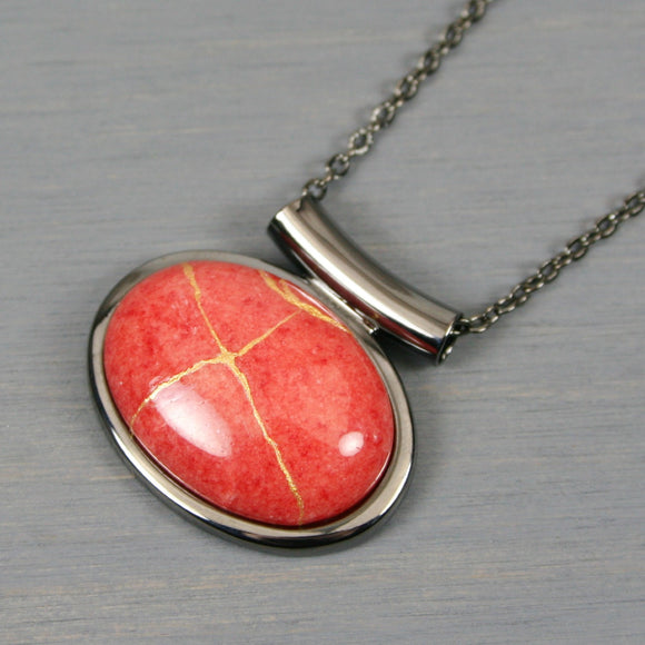 Coral dolomite stone kintsugi pendant in a gunmetal setting on chain