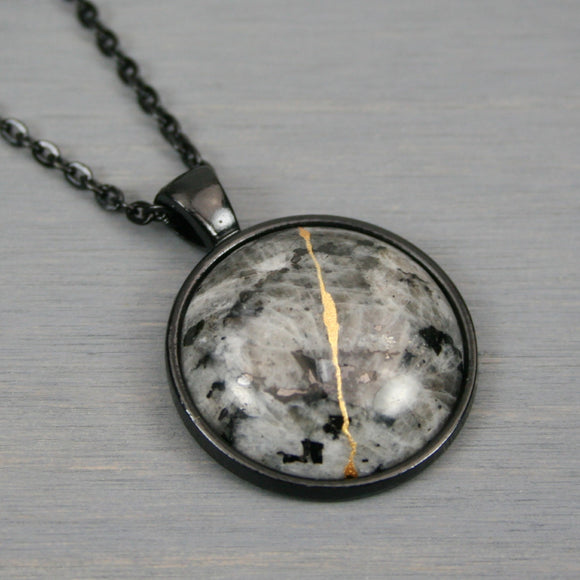 Larvikite (or blue labradorite) kintsugi pendant in black setting on chain