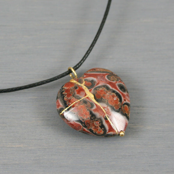 Poppy jasper broken heart pendant with kintsugi repair on black cotton cord