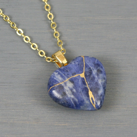 Sodalite broken heart pendant with kintsugi repair on chain necklace