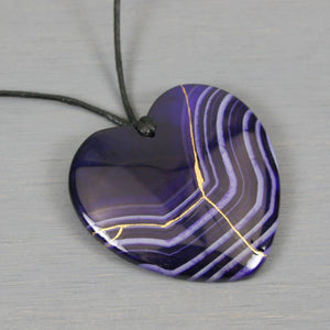 Dark purple banded agate broken heart pendant with kintsugi repair on black cotton cord