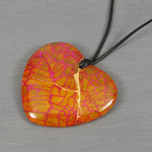 Yellow and pink dragon veins agate broken heart pendant with kintsugi repair on black cotton cord