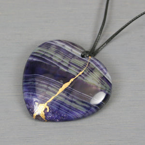 Dark purple and green agate broken heart pendant with kintsugi repair on black cotton cord