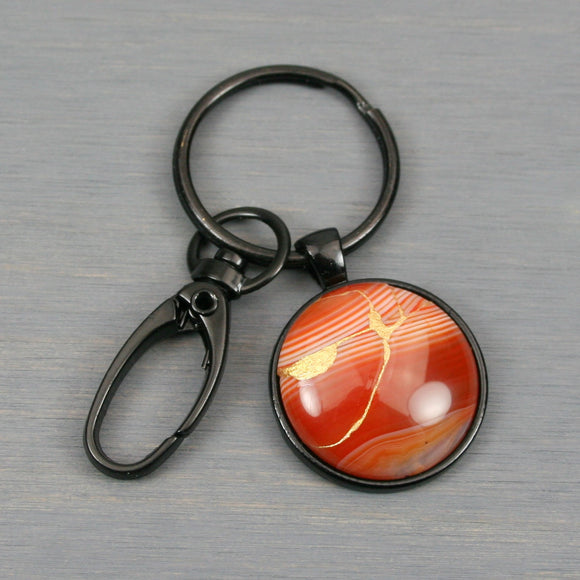 Red banded agate kintsugi key chain with black swivel lobster claw