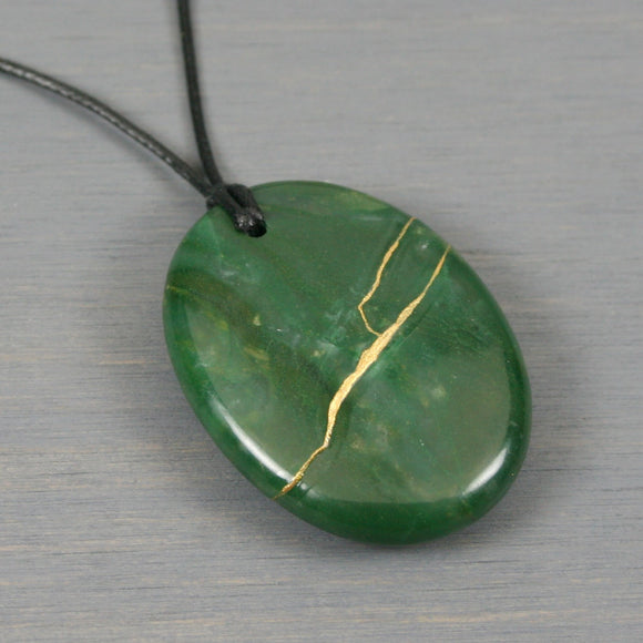African aventurine pendant with kintsugi repair on black cotton cord
