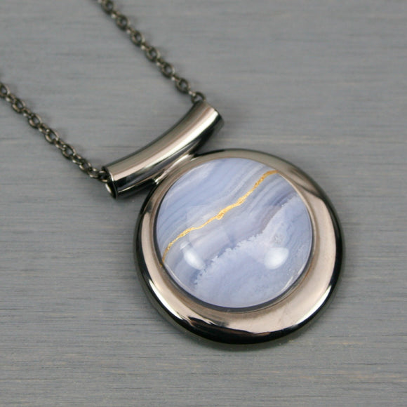 Blue lace agate kintsugi pendant in a gunmetal setting on chain