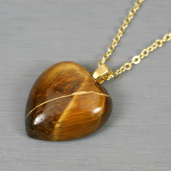 Tiger eye broken heart pendant with kintsugi repair on chain necklace