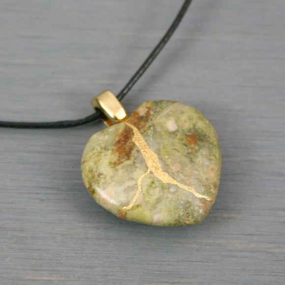 Autumn jasper broken heart pendant with kintsugi repair on black cotton cord